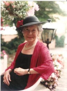 my adoptive mother Irene looking glamorous as always in a hat and an outfit she sewed.